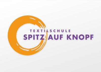 Textilschule Spitz auf Knopf